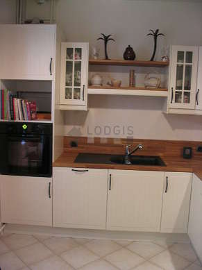 Great kitchen of 12m² with tile floor