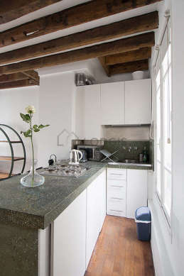Kitchen where you can have dinner for 3 person(s) equipped with hob, refrigerator, freezer, crockery