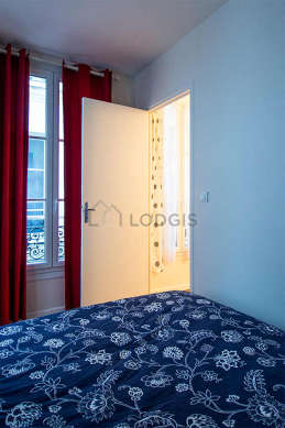 Bright bedroom equipped with wardrobe, cupboard