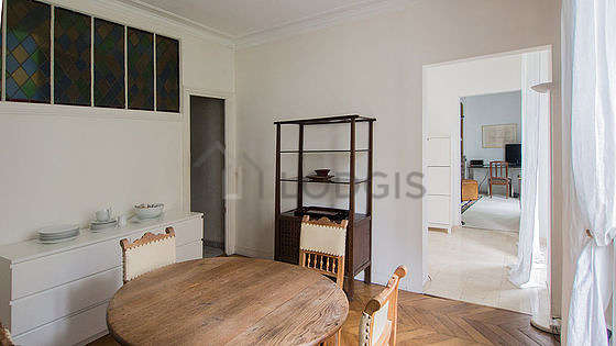Dining room of 15m² equipped with dining table, sideboard, fireplace
