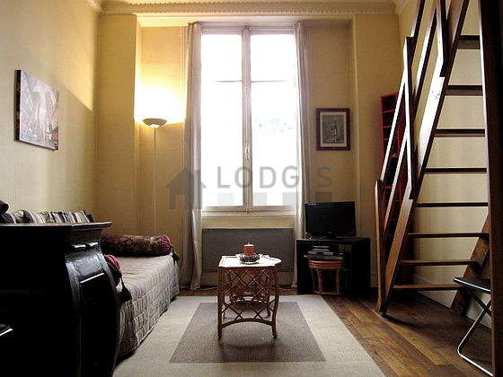 Quiet living room furnished with 1 sofabed(s) of 90cm, 1 loft bed(s) of 140cm, tv, wardrobe