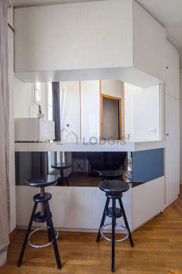 Kitchenopens on the living room with tile floor