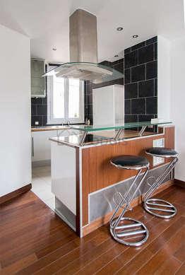 Magnifique cuisine de 5m²ouverte sur le séjour avec du carrelage au sol