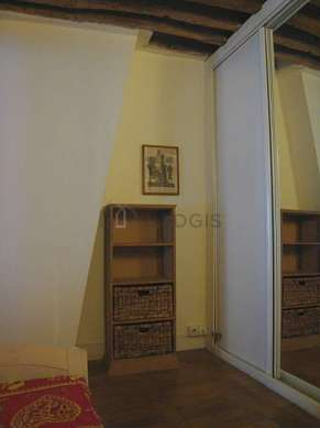 Alcove with wooden floor close to the living room