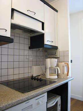 Bright kitchen with windows facing the road