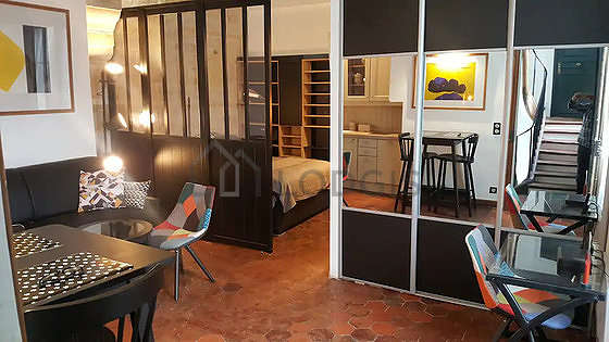 Very quiet living room furnished with 1 bed(s) of 140cm, tv, hi-fi stereo, 2 armchair(s)