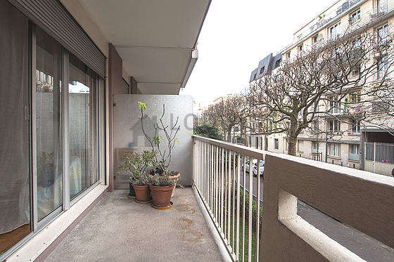 Balcony facing due south and view on road