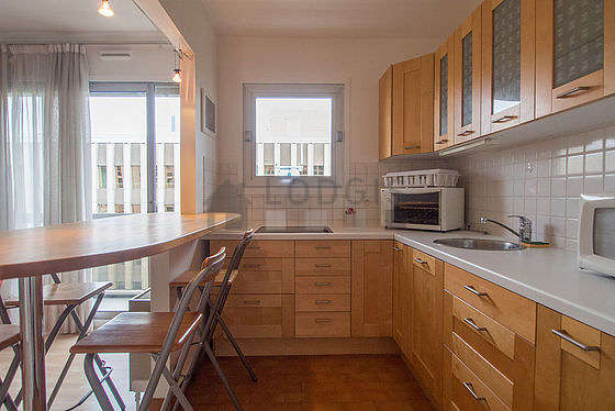 Kitchen where you can have dinner for 4 person(s) equipped with hob, refrigerator, cookware, stool