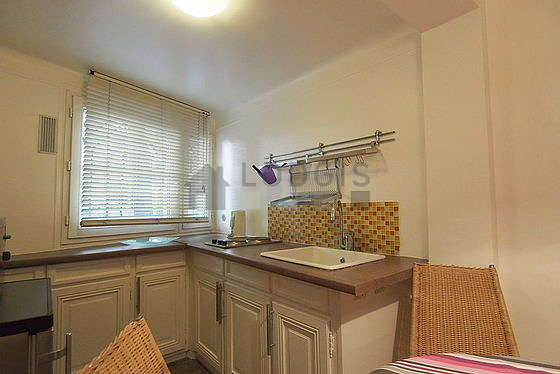 Kitchen where you can have dinner for 4 person(s) equipped with washing machine, refrigerator, freezer, crockery