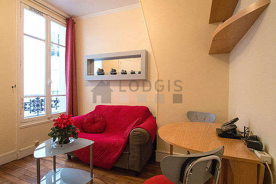 Very quiet living room furnished with tv, dvd player, 2 chair(s)