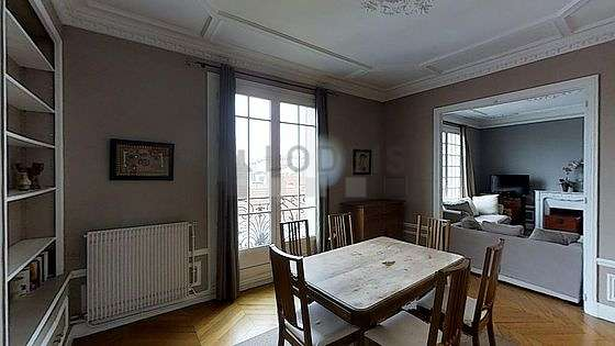 Dining room of 17m² equipped with dining table, cupboard