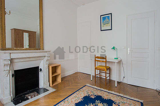 Bright bedroom equipped with desk, closet, 2 chair(s)