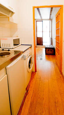 Kitchen equipped with washing machine, refrigerator, freezer, cookware