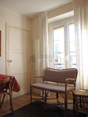 Quiet living room furnished with 1 bed(s) of 90cm, hi-fi stereo, wardrobe, 4 chair(s)