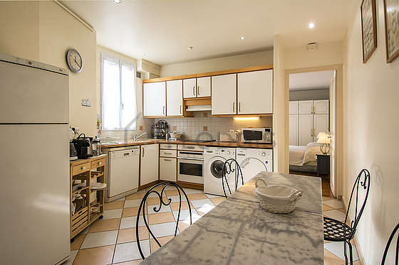 Kitchen where you can have dinner for 6 person(s) equipped with washing machine, dryer, refrigerator, hood