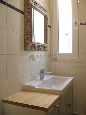 Very bright bathroom with tile floor
