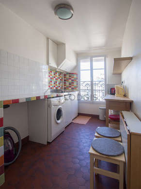 Kitchen where you can have dinner for 4 person(s) equipped with washing machine, refrigerator, crockery, stool