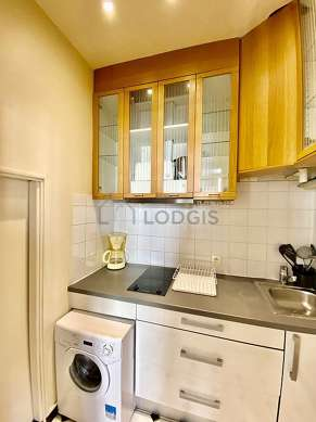 Kitchen equipped with washing machine, cookware