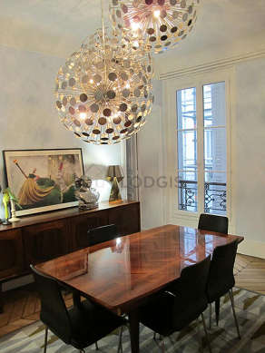 Dining room equipped with dining table, sideboard