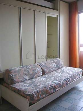 Very quiet living room furnished with 1 bed(s) of 140cm, tv, dvd player, wardrobe