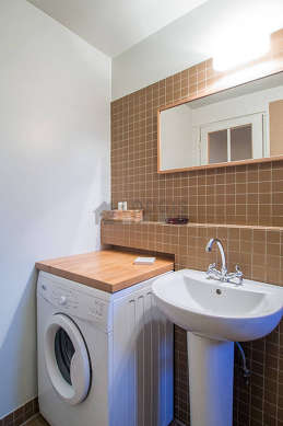 Beautiful and bright bathroom with double-glazed windows and with tile floor
