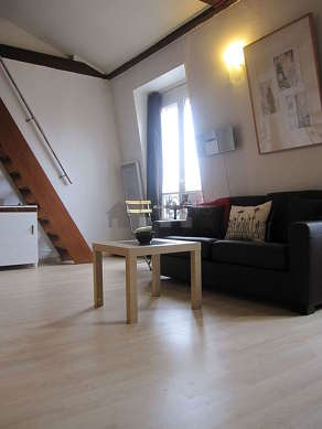 Quiet living room furnished with 1 futon(s) of 140cm, tv, hi-fi stereo, wardrobe