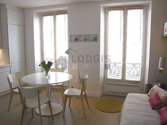Quiet living room furnished with 1 bed(s) of 90cm, dining table, coffee table, 4 chair(s)