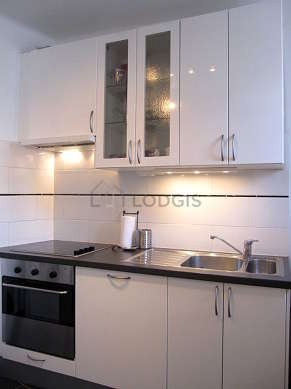 Kitchen where you can have dinner for 2 person(s) equipped with washing machine, refrigerator, freezer, extractor hood