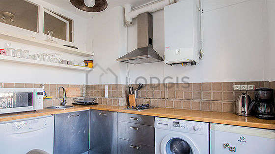 Kitchen where you can have dinner for 3 person(s) equipped with washing machine, refrigerator, freezer