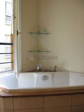 Bathroom equipped with washing machine, dryer, bath towels