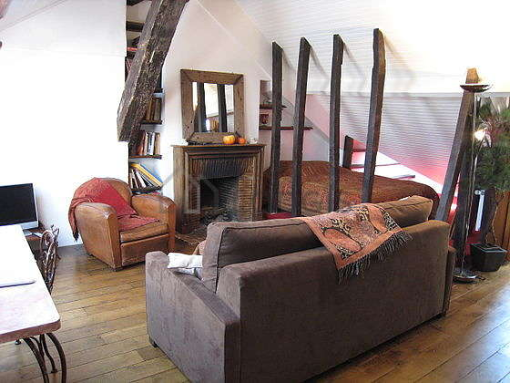 Very quiet living room furnished with 1 bed(s) of 160cm, 1 sofabed(s) of 160cm, tv, hi-fi stereo