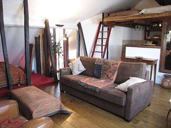 Very bright living room furnished with 1 armchair(s), 6 chair(s)