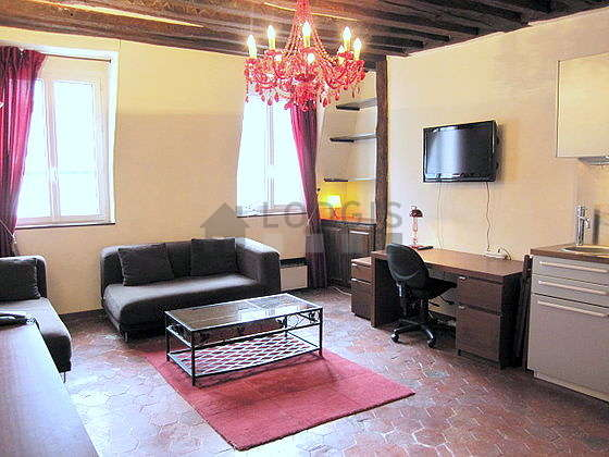 Very quiet living room furnished with tv, cupboard, 2 chair(s)