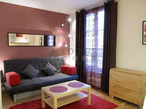 Quiet living room furnished with 1 sofabed(s) of 140cm, tv, wardrobe, cupboard