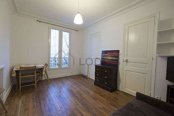 Very quiet living room furnished with 1 bed(s) of 90cm, dvd player, wardrobe, cupboard