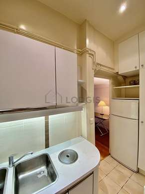 Kitchen equipped with washing machine, refrigerator, extractor hood, crockery