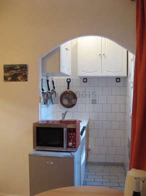 Kitchen equipped with hob, refrigerator, freezer