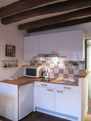 Kitchen where you can have dinner for 2 person(s) equipped with hob, refrigerator, freezer, extractor hood