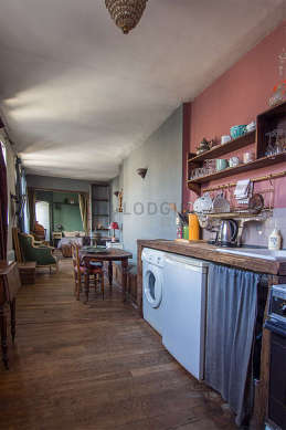 Beautiful kitchen of 8m² with wooden floor