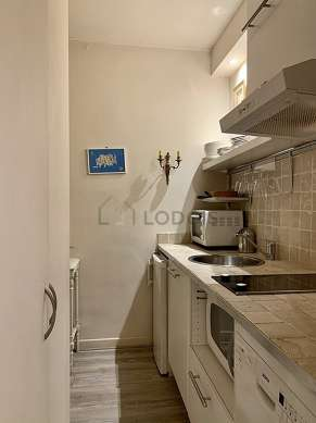 Beautiful kitchen with the carpeting floor