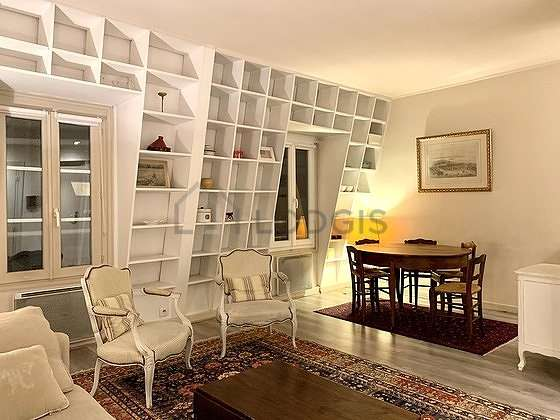 Quiet living room furnished with 1 sofabed(s) of 140cm, 2 armchair(s), 5 chair(s)