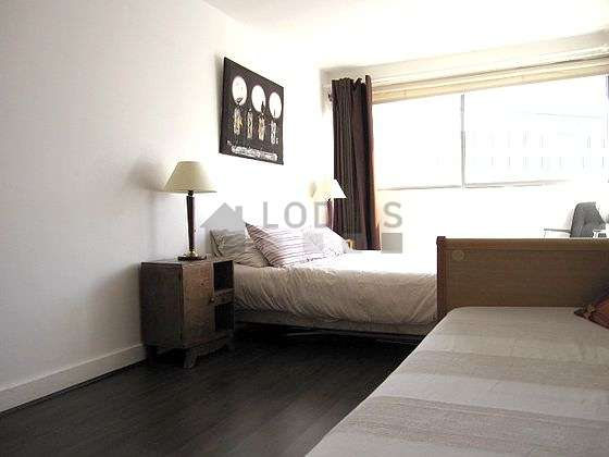 Bedroom with its wooden floor